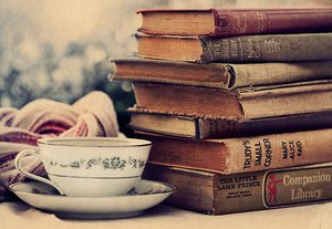 a_stack_of_books_and_a_good_cup_of_tea_by_mind_wolf-d7dnka5